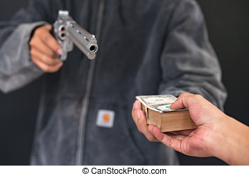 Man carrying a gun to rob the money