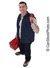 Man carrying a toolbox and a pipe wrench
