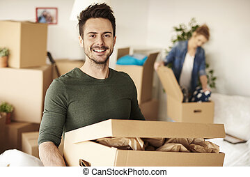 Man carrying box for new house