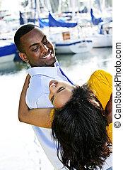 Man carrying girlfriend