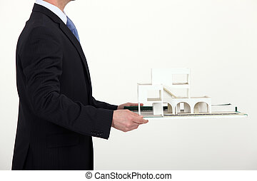 Man carrying model housing