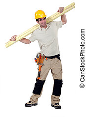 Man carrying planks of wood