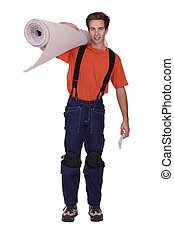 Man carrying roll of carpet over shoulder