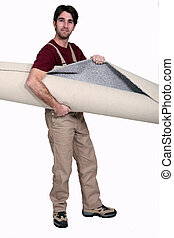 Man carrying rolled carpet