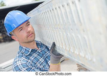 Man carrying scaffolding platform