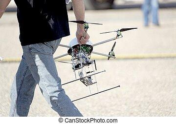 man carrying uav drone