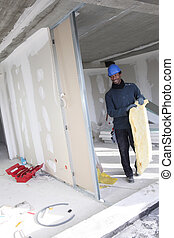 Man carrying wall insulation