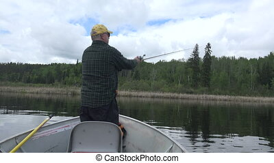 Man Casting out of Front of Fishing - A 4k clip from Red...