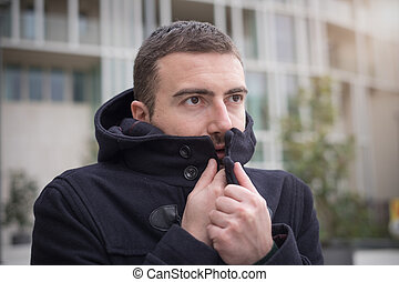Man casual dressed in the city on a winter seasonal day