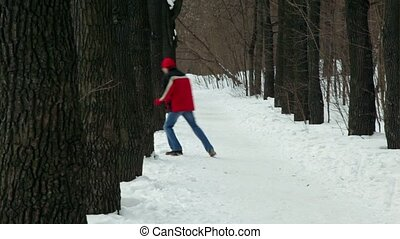 Man catches up with woman among trees at park lane at...