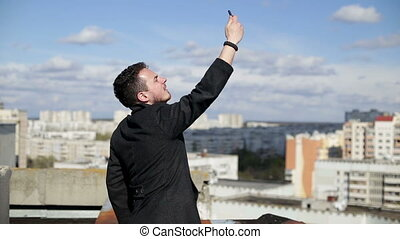 Man catches wifi on the roof.