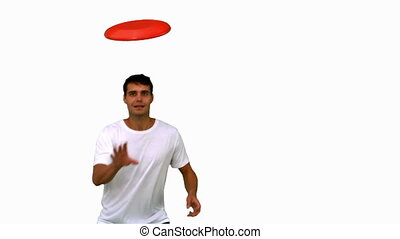 Man catching a frisbee on white scr