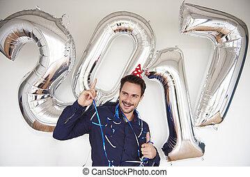 Man celebrating the upcoming year
