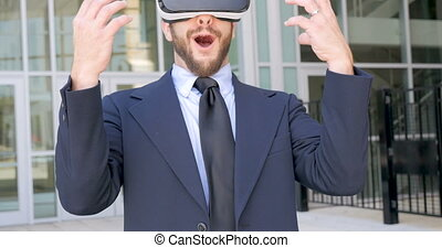 Man celebrating victory in a virtual reality experience with VR headset outside