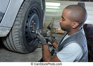 man changing tire