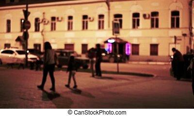 Man chase a boy. Urban night scene, Defocused. Toned shot vintage color.