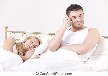 man cheating while woman sleeping