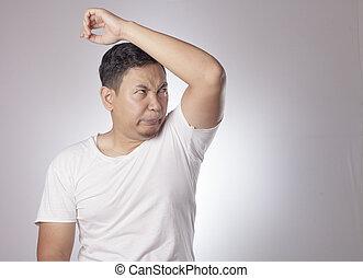 Man Check his Armpit Smell