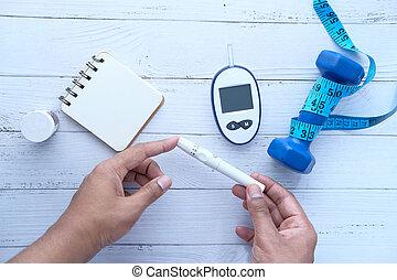 man checking blood sugar level, Top view