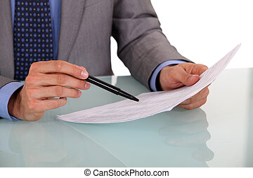 Man checking document before signing