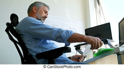Man checking document on desk 4k - Man checking document on...
