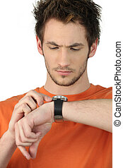 Man checking his wristwatch for the time