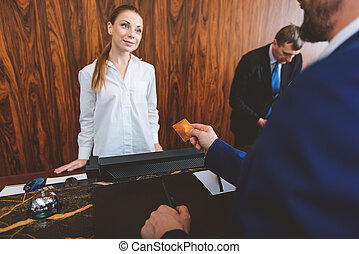 Man checking in at reception desk