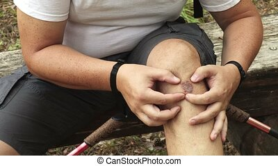Man checking leg injury