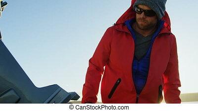 Man checking motorboat near river side 4k - Man checking...