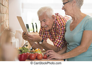Man checking the recipe on the tablet