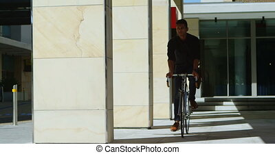Man checking time on smartwatch while riding bicycle 4k -...