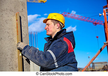Man checking vertical level