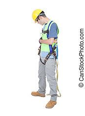 Man Checks Fastenings on Climbing Harness - A construction...