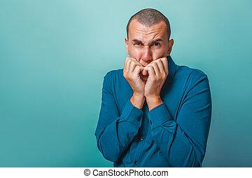 Man chewing fingernails