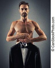 Man chooses a dress to wear