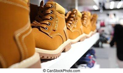 man chooses shoes in a shoe boutique, 4k, slow motion - man...