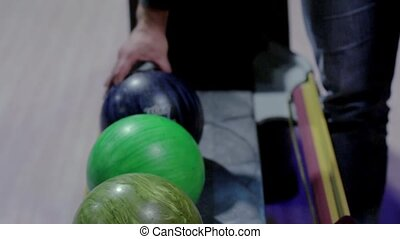 man chooses to throw the ball during a game of bowling