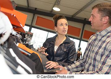 man choosing a lether jacket for motorbike