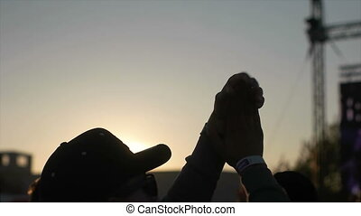 Man Clapping in the Air - Man Clapping with his hands in the...