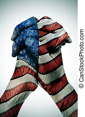 man clasped hands patterned with the american flag
