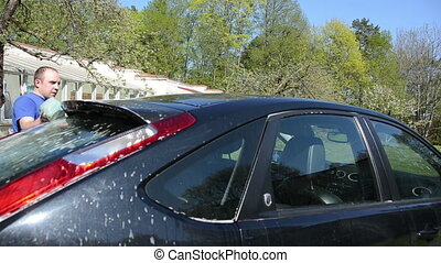 man clean car roof