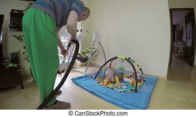 man clean floor baby