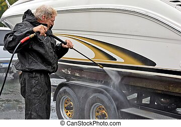 man cleaning boat hull