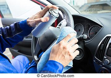 Man Cleaning Car Steering Wheel