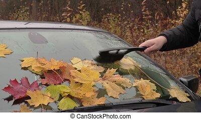 Man cleaning car window