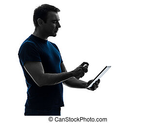 man cleaning dusting digital tablet silhouette
