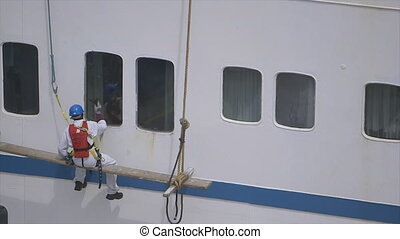 Man cleaning Mercy hospital ship windows, Conakry - Medium...