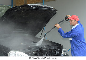 man cleaning the car engine