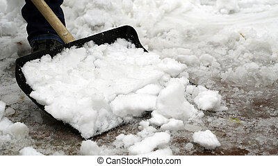 man cleans snow from the yard