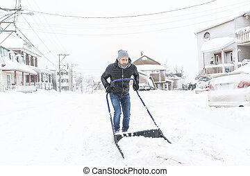 man cleans snow